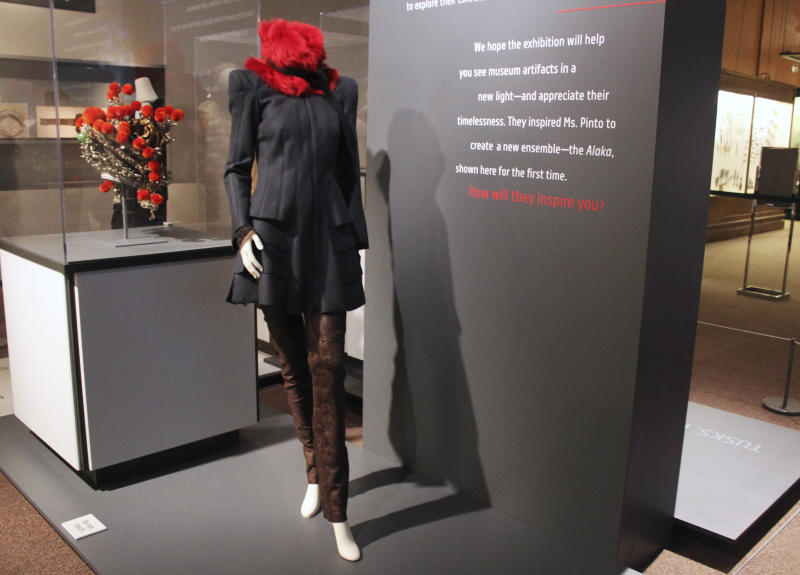 """In this Thursday, Sept. 13, 2012 photo, an ensemble created by fashion designer Maria Pinto is seen in the new exhibit """"Fashion and The Field Museum Collection: Maria Pinto"""" opening Friday, Sept. 14 at the museum in Chicago. This design was inspired by the Chinese theatrical headdress at left. The exhibit features Pinto designs alongside antiquities from the museum. (AP Photo/Caryn Rousseau)"""