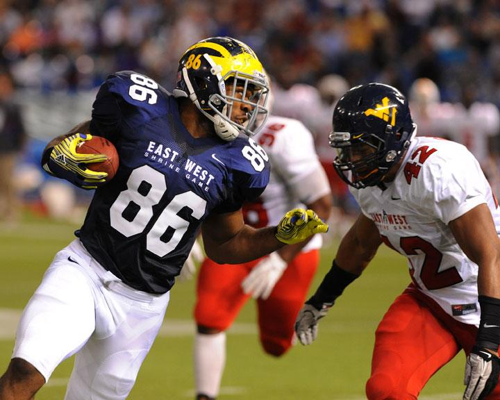 ST. PETERSBURG, FL - JANUARY 21: Tight end Kevin Koger #86 of University of Michigan Wolverines rushes upfield with a pass during the 87th annual East-West Shrine game January 21, 2012 at Tropicana Field in St. Petersburg, Florida. (Photo by Al Messerschmidt/Getty Images)