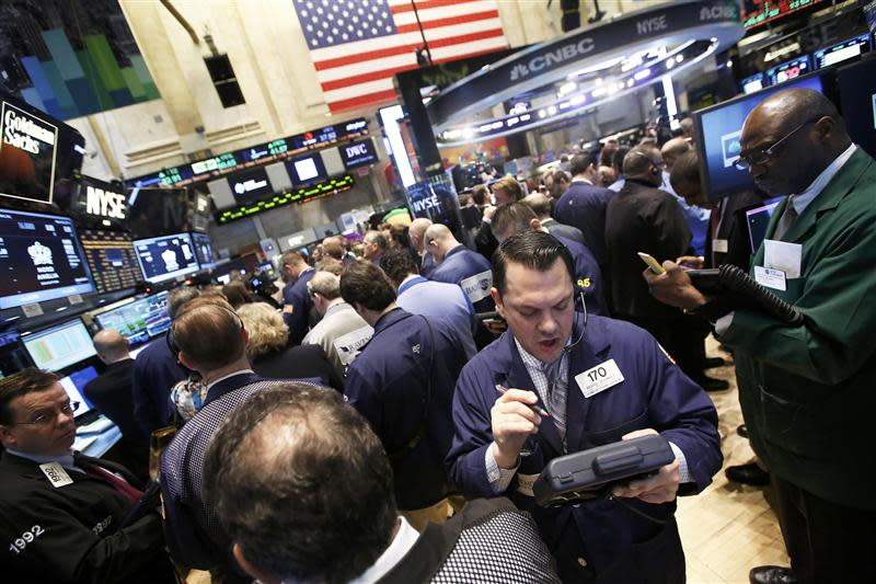 Ttraders work during the IPO of Mobile game maker King Digital Entertainment Plc on the floor of the New York Stock Exchange