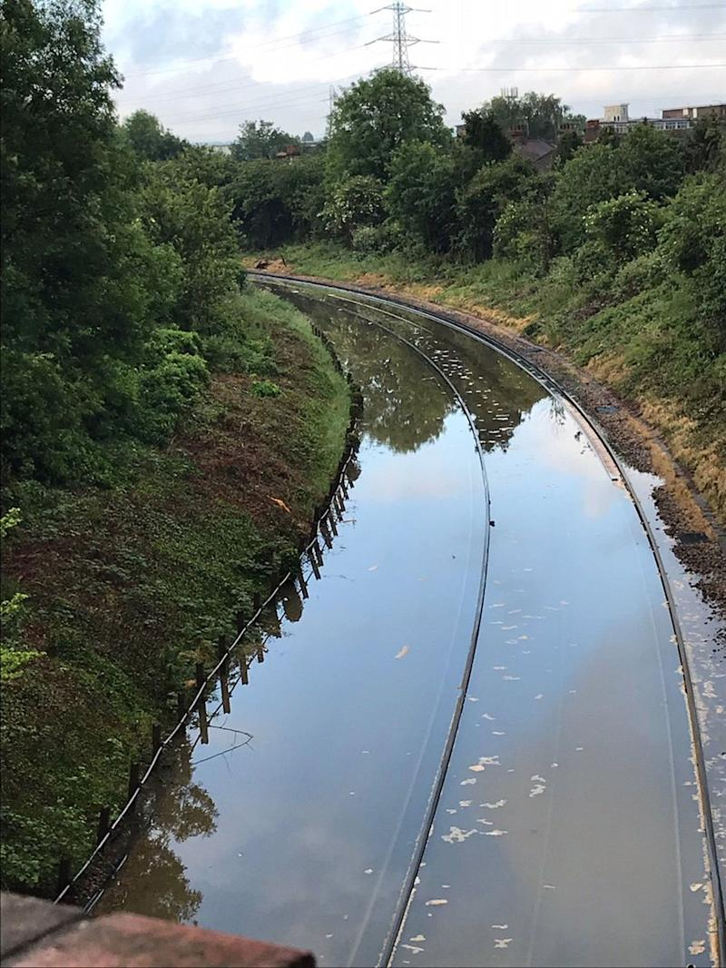 Railway lines have been flooded at Mitcham Junction in the London borough of Merton (Picture: PA)