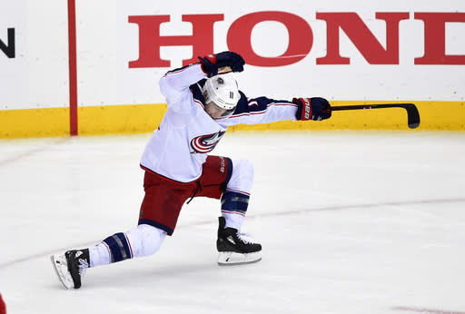 Columbus Blue Jackets left wing Matt Calvert (11) celebrates his game-winning goal in overtime in Game 2 of an NHL first-round hockey playoff series against the Washington Capitals, Sunday, April 15, 2018, in Washington. The Blue Jackets won 5-4 in overtime. (AP Photo/Nick Wass)