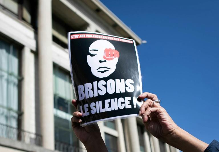 "A person holds a sign reading, ""Break the silence"" during a rally to denounce femicides and domestic violence in Le Havre, northwestern France, in September 2019 (AFP Photo/Lou BENOIST)"