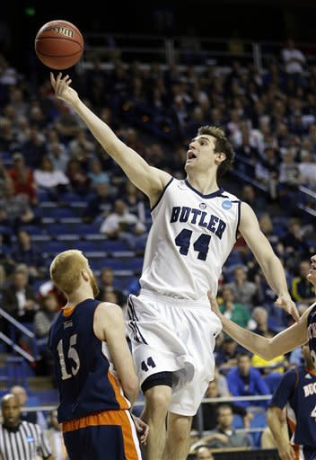 Butler center Andrew Smith (44) drives into Bucknell forward Joe Willman (15) as he goes up for a shot during the first half a of their second round NCAA college basketball tournament game Thursday, March 21, 2013, in Lexington, Ky. (AP Photo/John Bazemore)