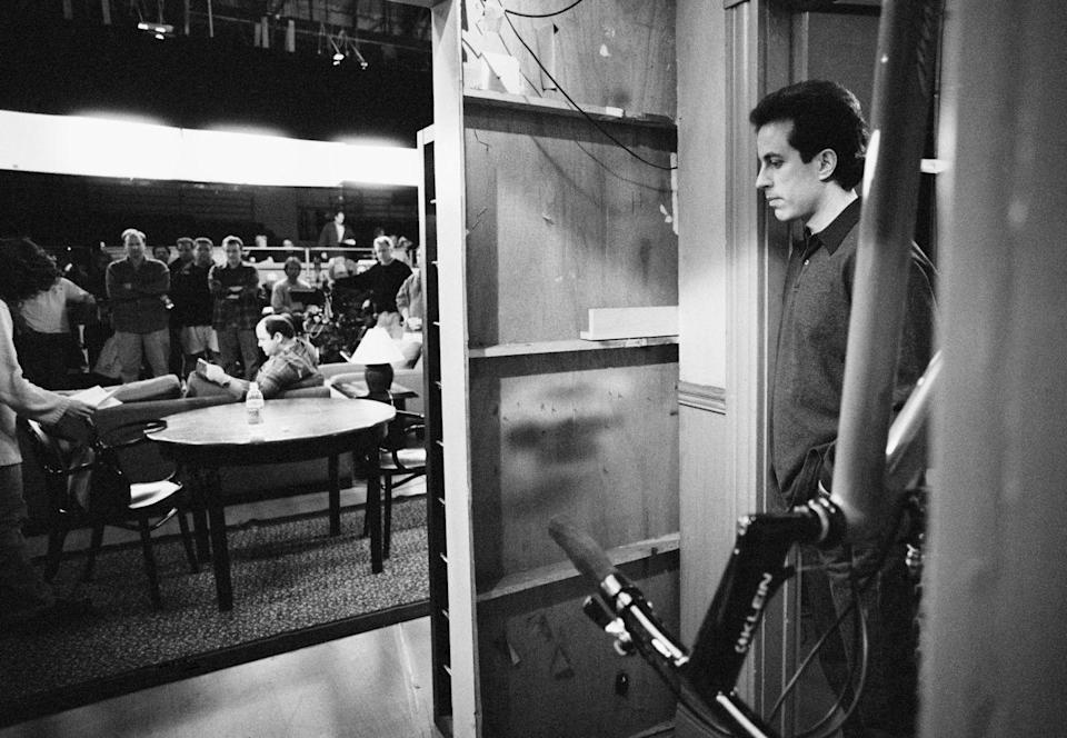 <p>Seinfeld is seen waiting for his cue to enter a scene, while taping the final episode of the show.</p>