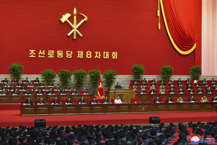 """In this photo provided by the North Korean government, North Korean leader Kim Jong Un, center, attends a ruling party congress in Pyongyang, North Korea Thursday, Jan. 7, 2021. Kim has reviewed relations with rival South Korea and underscored the need to drastically improve its ties with the outside world as he addressed a major political conference for the third consecutive day, state media reported Friday. Independent journalists were not given access to cover the event depicted in this image distributed by the North Korean government. The content of this image is as provided and cannot be independently verified. Korean language watermark on image as provided by source reads: """"KCNA"""" which is the abbreviation for Korean Central News Agency. (Korean Central News Agency/Korea News Service via AP)"""