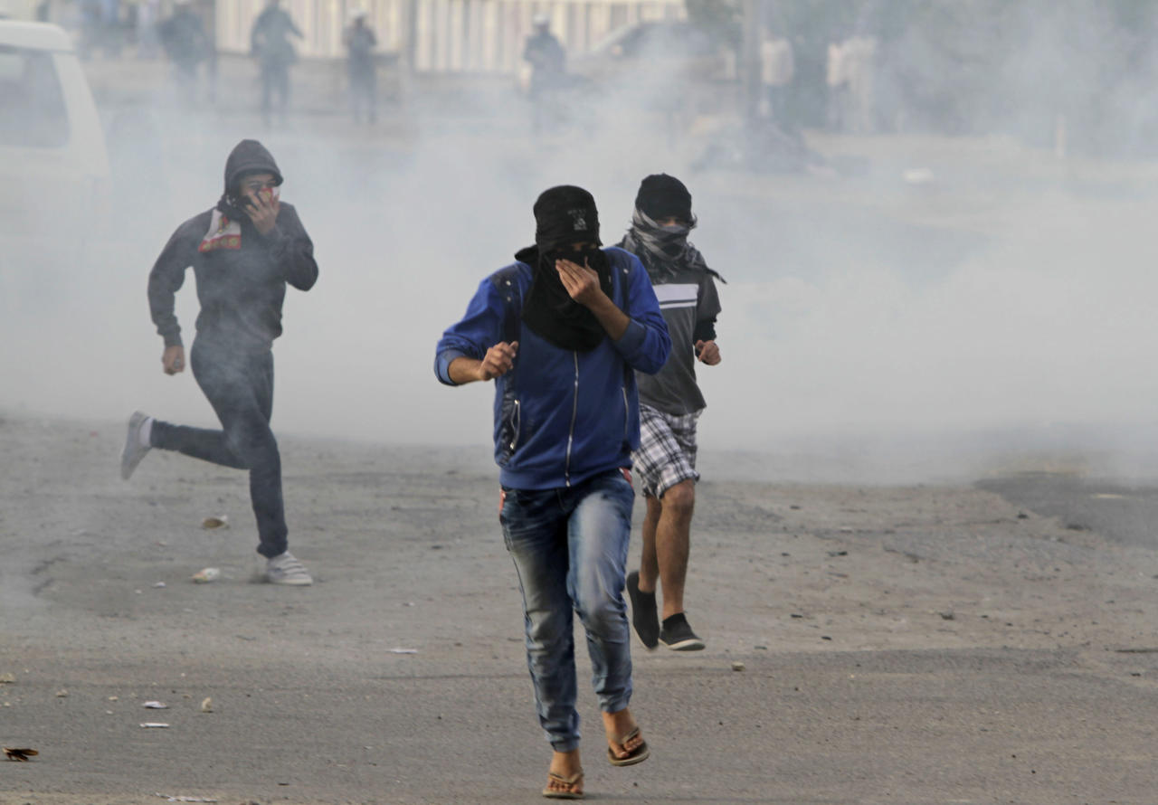 Bahraini anti-government protester clash with riot police firing tear gas Thursday, March 8, 2012, in Saar, Bahrain, west of the capital of Manama. (AP Photo/Hasan Jamali)