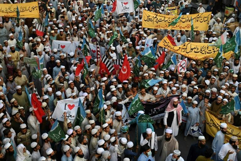 Muslim demonstrators march in Lahore on Wednesday against French President Emmanuel Macron
