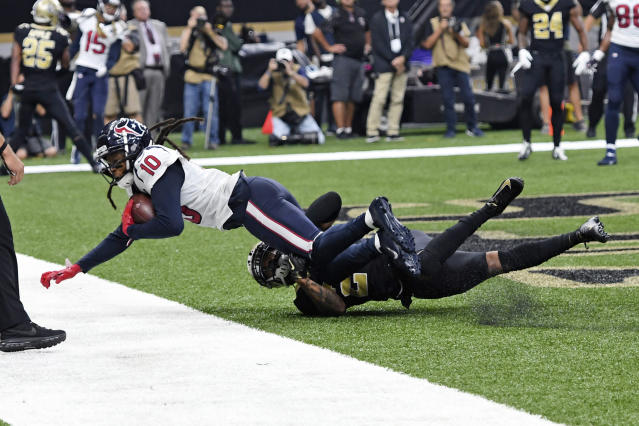 Houston Texans wide receiver DeAndre Hopkins (10) scores a touchdown against New Orleans Saints cornerback Marshon Lattimore in the first half of an NFL football game in New Orleans, Monday, Sept. 9, 2019. (AP Photo/Bill Feig)