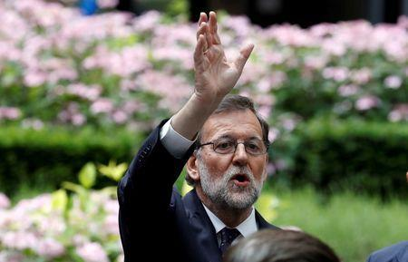 Spanish Prime Minister Mariano Rajoy waves as he waits for his car at the end of the second day of the EU Summit in Brussels, Belgium June 29, 2016. REUTERS/Phil Noble
