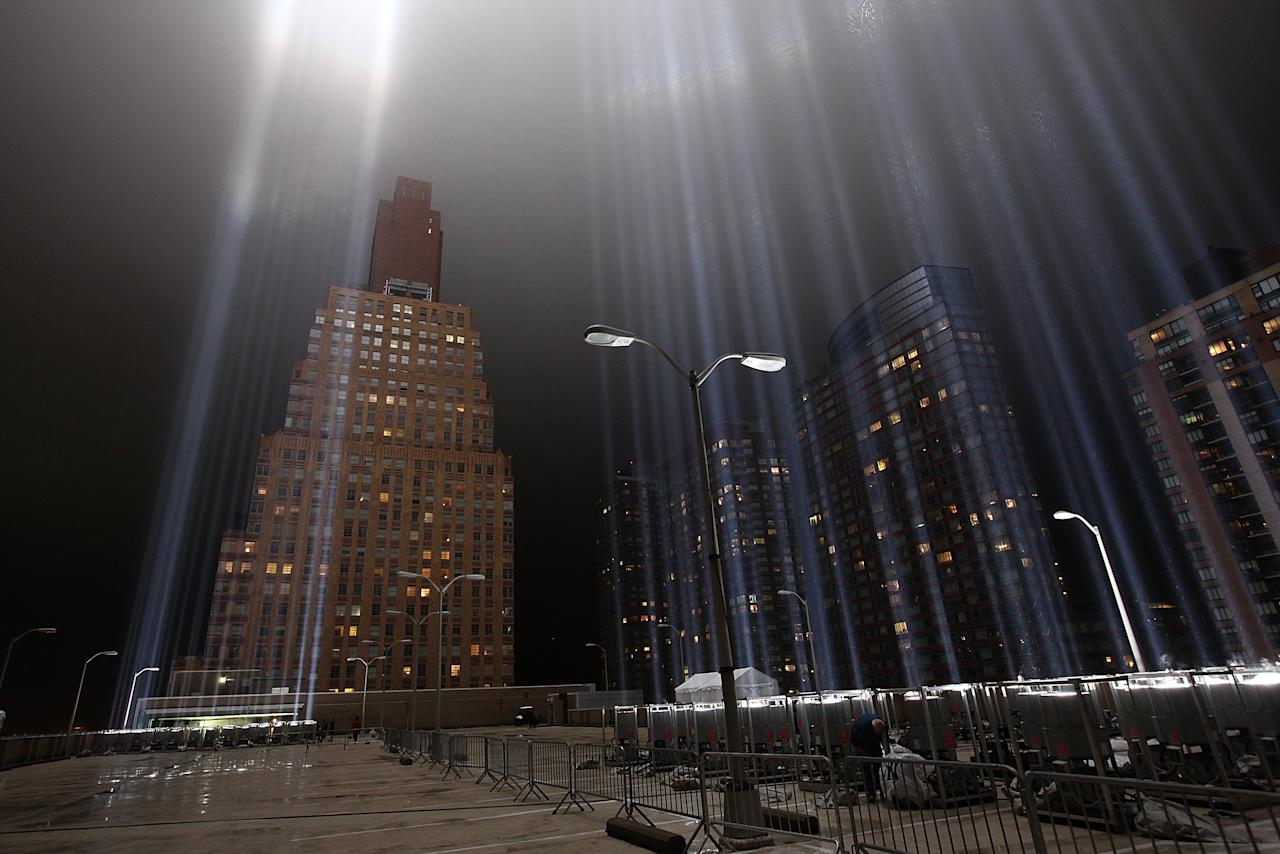 NEW YORK, NY - SEPTEMBER 07:  The Tribute in Lights illuminates from the top of a parking garage ahead of the tenth anniversary of the September 11 terrorist attacks on September 7, 2011 in New York City. The Tribute in Light is comprised of 88 7000 watt searchlights that beam into the sky near the site of the World Trade Center in remembrance of the September 11 attacks.  (Photo by Justin Sullivan/Getty Images)