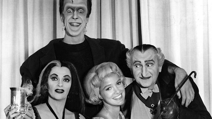 The Munsters cast members Fred Gwynne, Yvonne De Carlo, Beverley Owen, and Al Lewis. (Credit: Everett Collection)