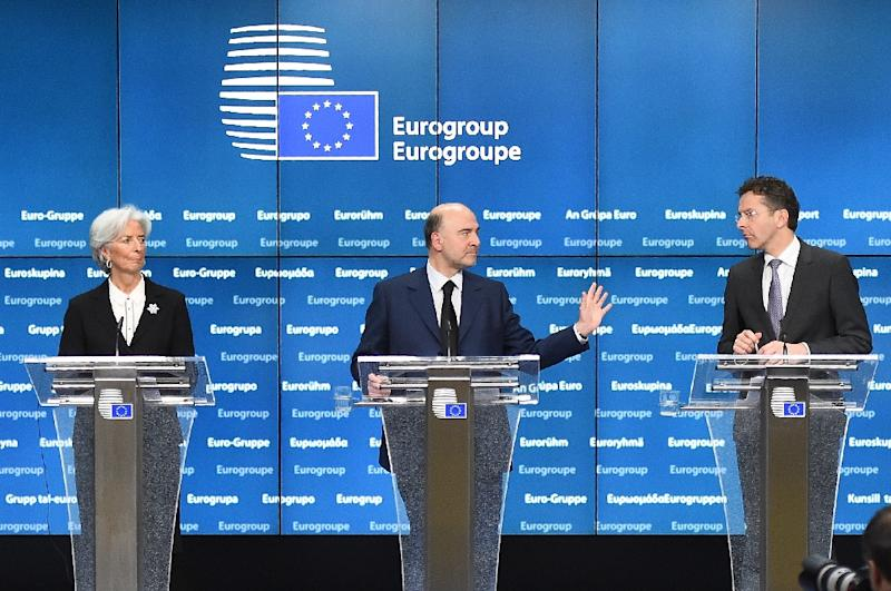Greek troika members (L-R) IMF chief Christine Lagarde, European Commissioner for Economic and Financial Affairs, Taxation and Customs Pierre Moscovici and Eurogroup President and Dutch Finance Minister Jeroen Dijsselbloem (AFP Photo/Emmanuel Dunand)