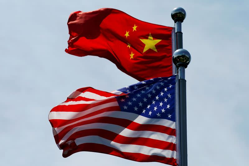 TOFILE PHOTO: Chinese and U.S. flags flutter near The Bund in Shanghai