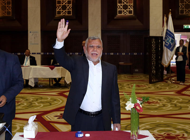 In this Saturday, May 12, 2018 file photo, Hadi al-Amiri, commander of the Popular Mobilization Forces, gestures after casting his ballot in the country's parliamentary elections in the heavily fortified Green Zone in Baghdad, Iraq. The unexpected alliance between Iraq's mercurial Shiite cleric Muqtada al-Sadr and an Iran-backed coalition of powerful Shiite militias, who fought Islamic State group, will boost Tehran interests in Iraq and give it more leverage over the process of forming the next government. (AP Photo/Karim Kadim, File)