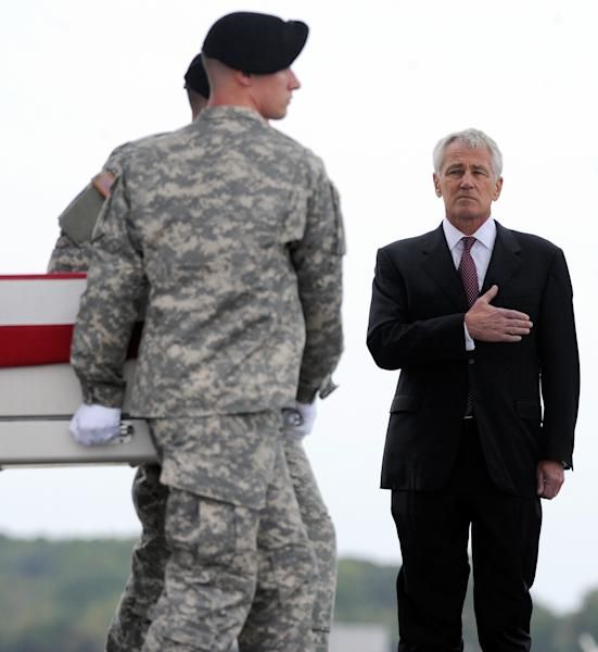 Defense Secretary Chuck Hagel, right, watches an Army carry team move a transfer case containing the remains of Pfc. Cody J. Patterson Wednesday, Oct. 9, 2013 at Dover Air Force Base, Del. According to the Department of Defense, Patterson, 24, of Philomath, Ore., died Oct. 6, 2013 in Zhari district, Afghanistan of injuries sustained when enemy forces attacked his unit with an improvised explosive device. (AP Photo/Steve Ruark)
