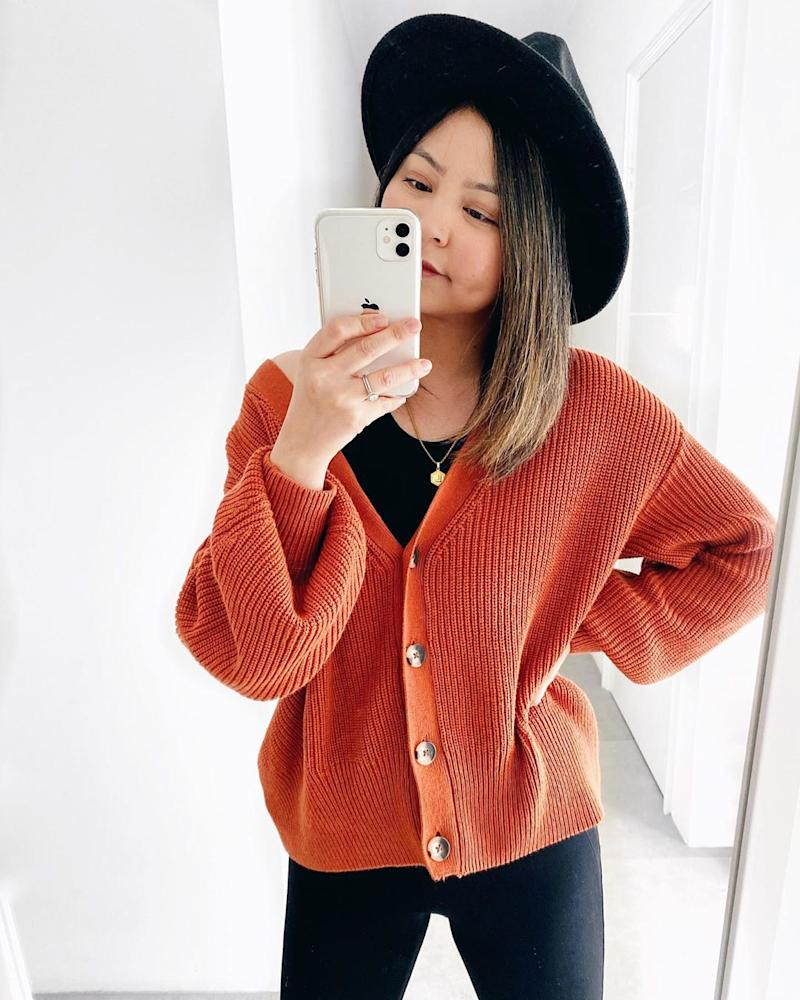 Woman in burnt orange cardigan