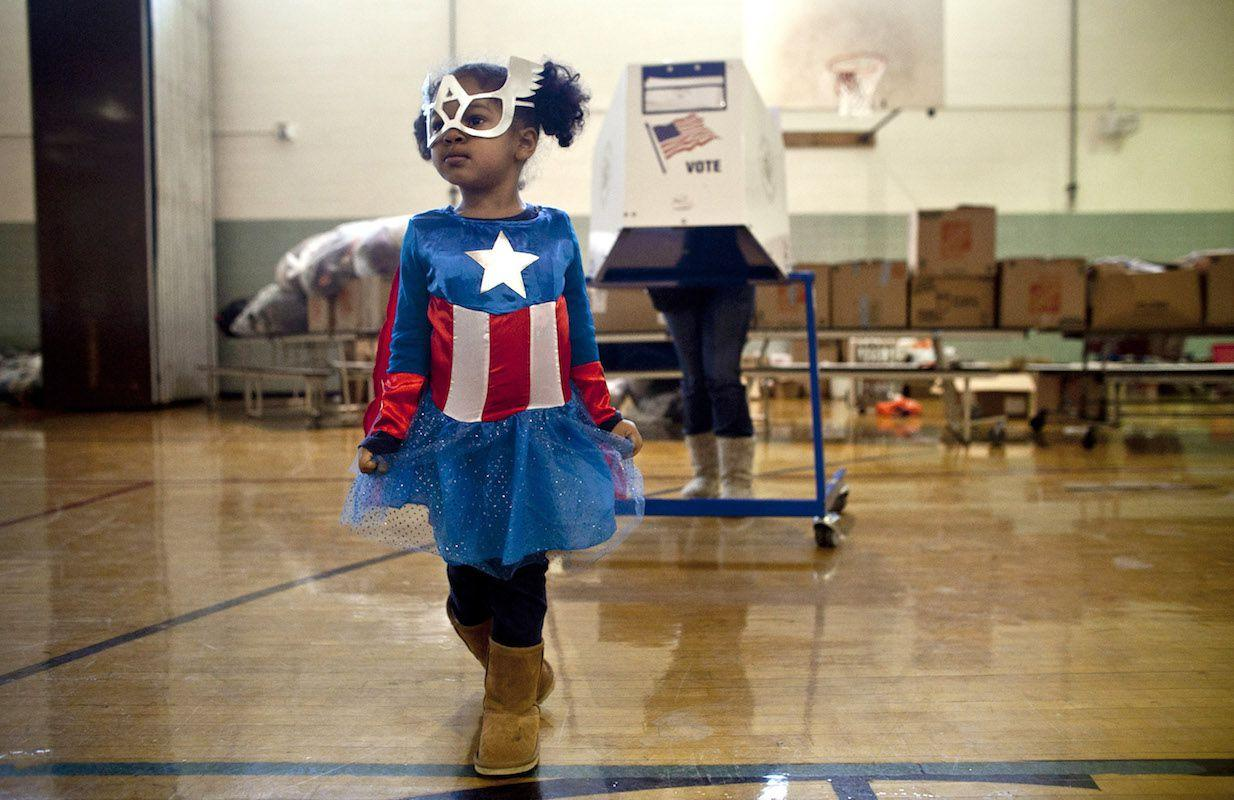 <p>Three-year-old Raena Lamont hung out at a donation center-turned-polling station in Staten Island in November 2012, just two weeks after Hurricane Sandy wreaked havoc on the area.</p>