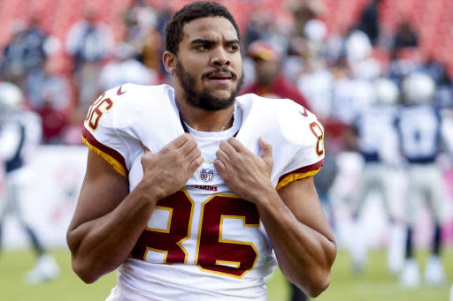 FILE - In this Oct. 21, 2018, file photo, Washington Redskins tight end Jordan Reed (86), warm up before an NFL football game against the Dallas Cowboys, in Landover, Md. Reed is expected to make his season debut for the Redskins on Sunday, Sept. 15, 2019, after recovering from whats believed to be his fifth documented concussion in the NFL and seventh dating back to college. Concussions continue to be a concern for Reed, whose value to the Redskins might be as high as any player they have.(AP Photo/Andrew Harnik, File)
