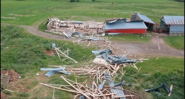 Jeff McCurdy captured this image of a barn flattened by a short, violent storm in Stewiacke this week.  (Submitted by Jeff McCurdy - image credit)