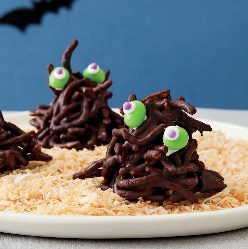 """<p>Chocolate-covered chow mein noodles are the secret to these creepy monsters.</p><p><em><a href=""""https://www.womansday.com/food-recipes/food-drinks/recipes/a11427/haystack-creatures-recipe-122706/"""" rel=""""nofollow noopener"""" target=""""_blank"""" data-ylk=""""slk:Get the recipe from Woman's Day »"""" class=""""link rapid-noclick-resp"""">Get the recipe from Woman's Day »</a></em></p>"""