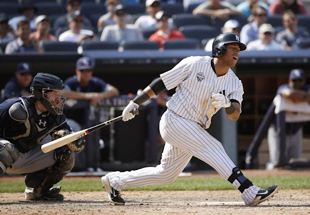 New York Yankees Yangervis Solarte reacts to striking out with Brian Roberts at second base in the eighth inning of a baseball game at Yankee Stadium in New York, Wednesday, July 2, 2014. (AP Photo/Kathy Willens)