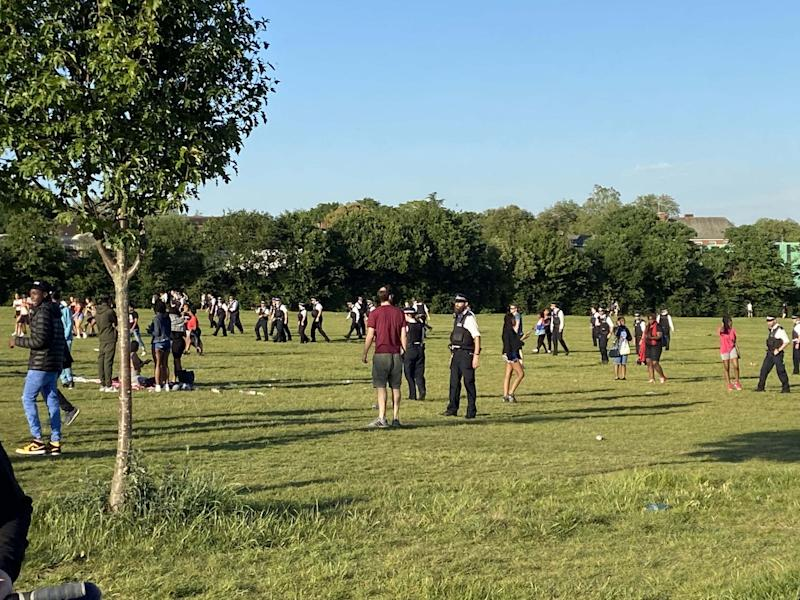 Police officers breaking up a large brawl on Hampstead Heath in north London on Tuesday evening: PA