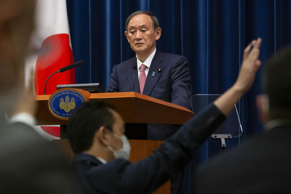 FILE - In this May 14, 2021, file photo, Japanese Prime Minister Yoshihide Suga speaks during a press conference at the prime minister's official residence, in Tokyo. With infections and serious cases rising despite a state of emergency, Suga has begun all-out efforts, from deploying military doctors and nurses at mass inoculation centers to allowing legal exceptions to recruit more people to give shots. But the realization here that it may be too little, too late to make a difference during the Olympics is starting to dawn. (Yuichi Yamazaki/Pool Photo via AP, File)