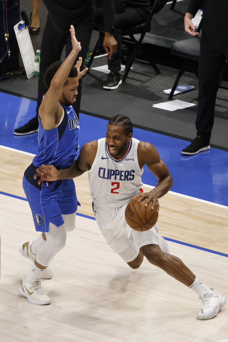 Los Angeles Clippers forward Kawhi Leonard (2) drives past Dallas Mavericks guard Jalen Brunson, left, in the second half during Game 6 of an NBA basketball first-round playoff series in Dallas, Friday, June 4, 2021. (AP Photo/Michael Ainsworth)