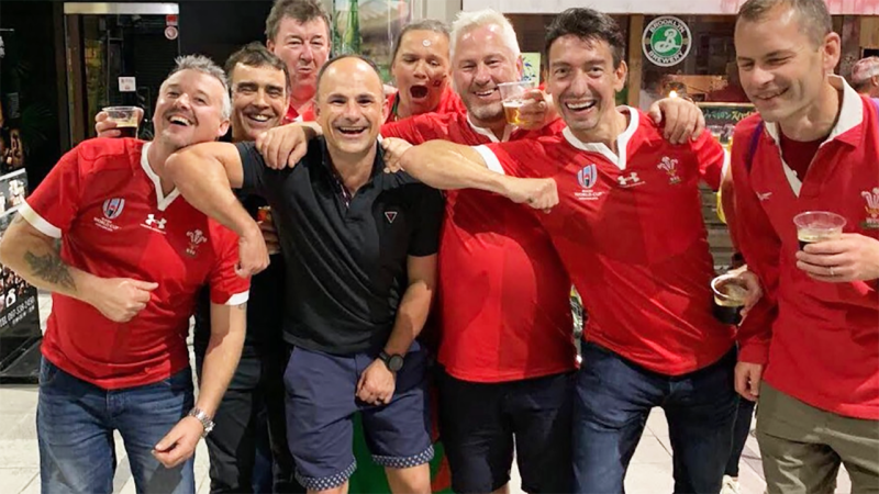 Jaco Peyper, pictured here posing with Welsh fans at the Rugby World Cup.