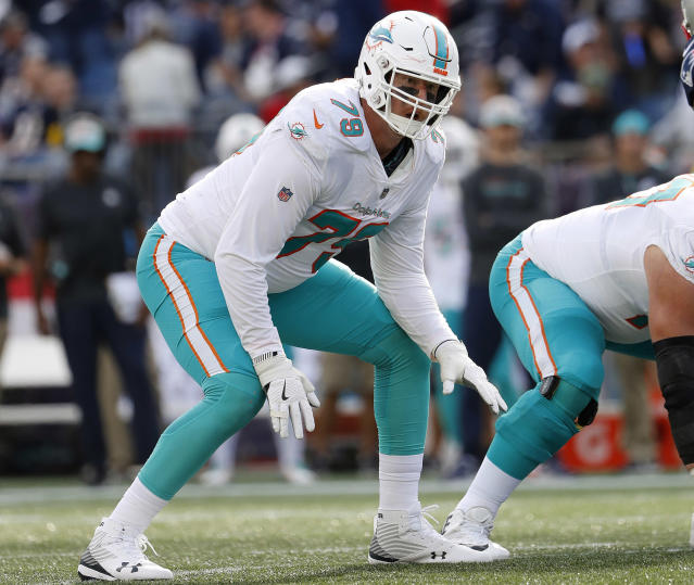 FILE - In this Sept. 30, 2018, file photo, Miami Dolphins offensive tackle Sam Young is shown in action during an NFL football game against the New England Patriots, in Foxborough, Mass. Last week the Miami Dolphins tried assigning eight players to help with pass protection, and even that didnt prevent Ryan Tannehill from getting hit. And now the Dolphins have to block Khalil Mack. (Winslow Townson/File)