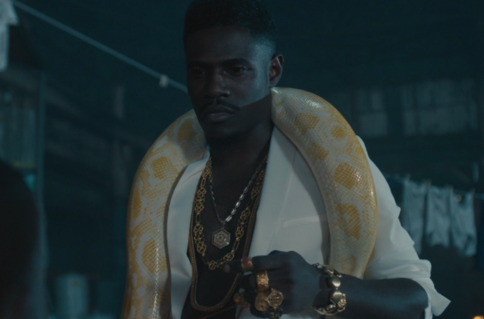 """<p>With a yellow boa constrictor around his shoulders (casual), Lord Afrixana introduces the track """"Dont Jealous Me"""" alongside Yemi Alade and Mr. Eazi.</p>"""