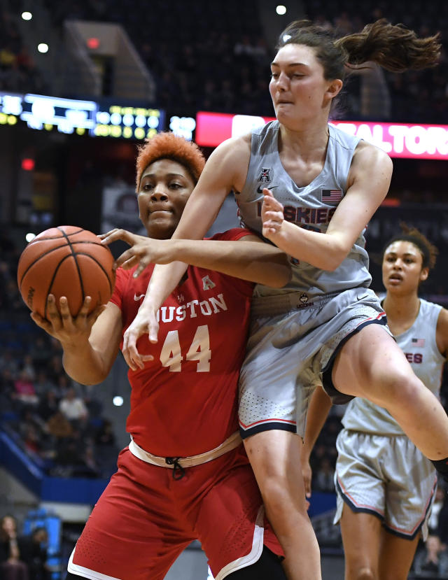 Connecticut's Molly Bent, right, fouls Houston's Jazmaine Lewis in the second half of an NCAA college basketball game, Saturday, Jan. 11, 2020, in Hartford, Conn. (AP Photo/Jessica Hill)
