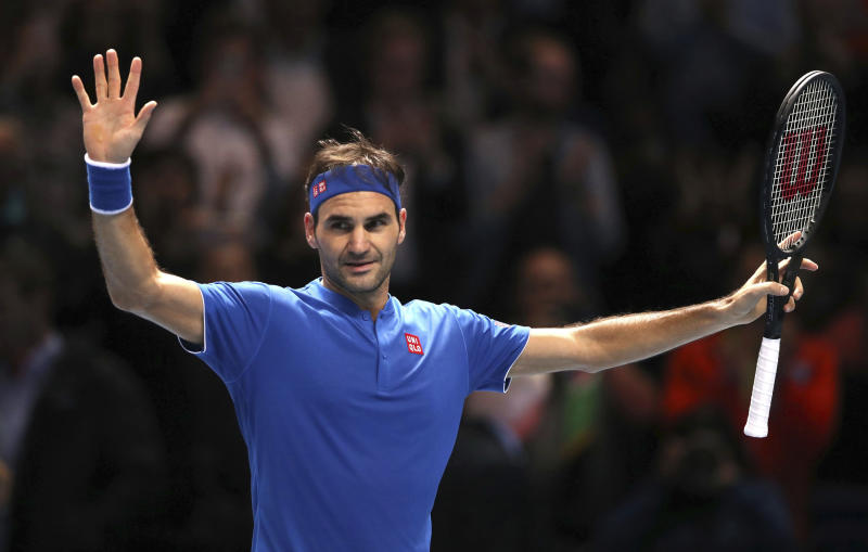 Switzerland's Roger Federer celebrates winning his ATP World Tour Finals men's singles tennis match against South Africa's Kevin Anderson at the O2 arena in London, Thursday, Nov. 15, 2018. (John Walton/PA via AP)