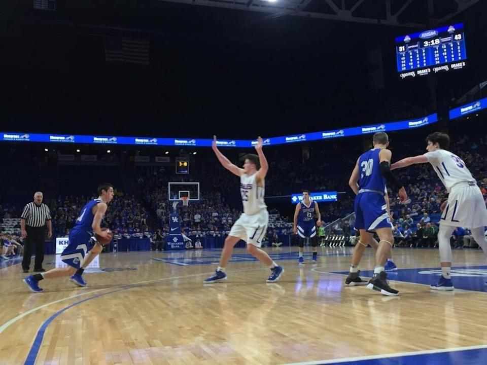In four games for Covington Catholic in the 2018 Kentucky Sweet Sixteen in Rupp Arena, CJ Fredrick, left, averaged 27.8 points per game while leading the Colonels to the state title.