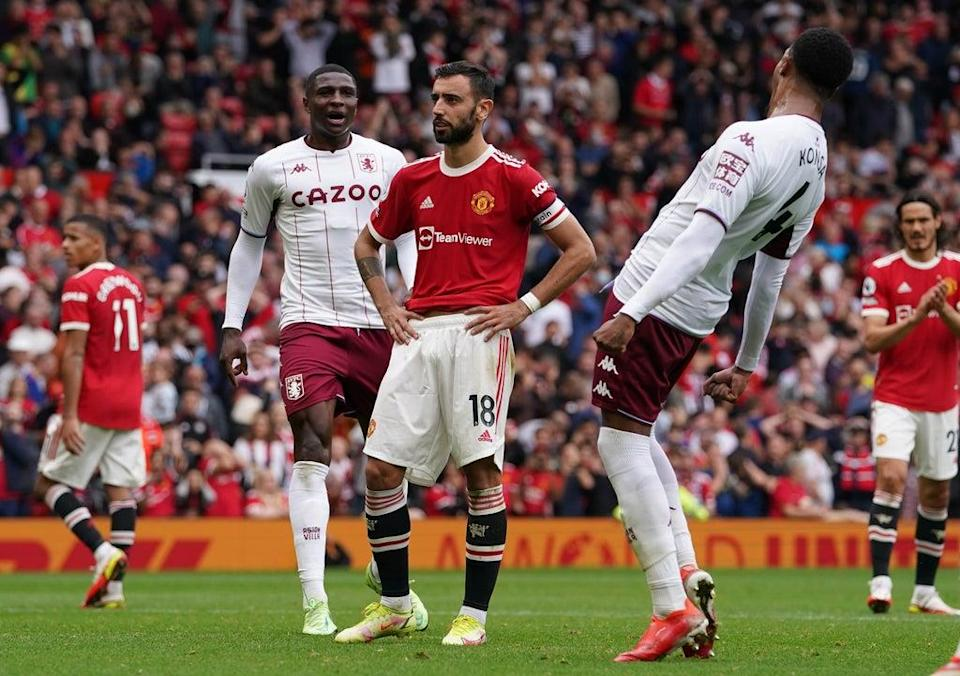 Manchester United's Bruno Fernandes (centre) reacts to his missed penalty against Aston Villa (Martin Rickett/PA) (PA Wire)