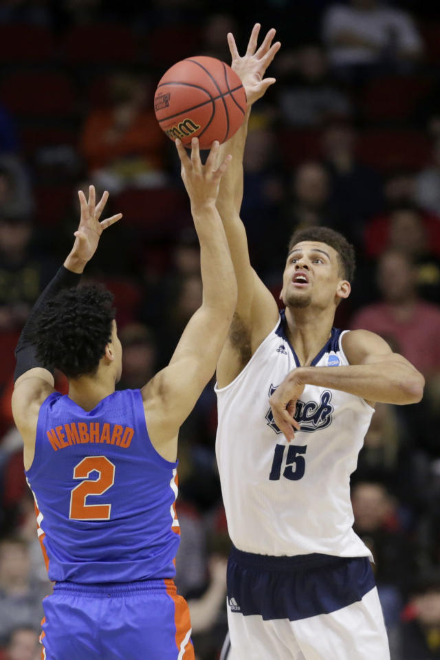 Nevada's Trey Porter (15) blocks a shot by Florida's Andrew Nembhard (2) during the first half of a first round men's college basketball game in the NCAA Tournament in Des Moines, Iowa, Thursday, March 21, 2019. (AP Photo/Nati Harnik)