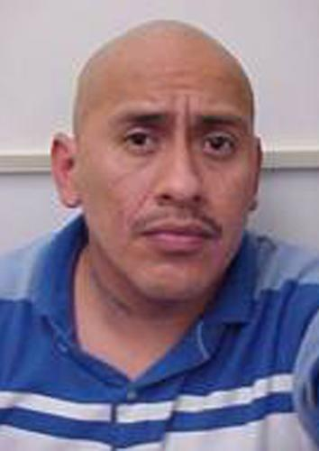 This undated photo provided by the Ridgecrest, Calif. police shows Sergio Munoz. Ridgecrest police have identified Munoz, 39, as the gunman who fatally shot a woman, injured another and then led police on a wild chase before he was killed in a shootout on Friday, Oct. 25, 2013. (AP Photo/Ridgecrest Police)