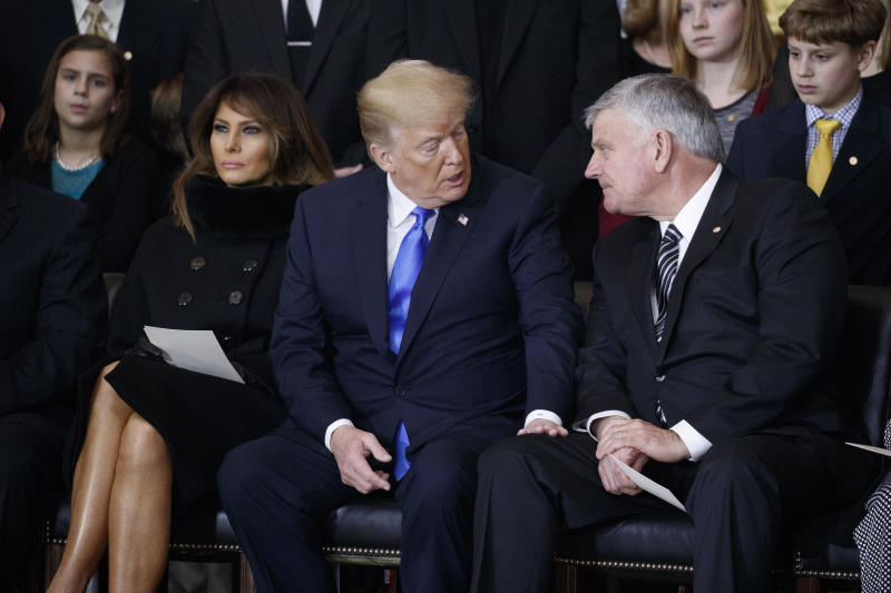"Franklin Graham with Trump at a ceremony honoring the late Billy Graham at the U.S. Capitol on Feb. 28. In an interview with the Christian Broadcasting Network, Franklin Graham said Blasey's allegation is ""not relevant."" (Pool / Getty Images)"