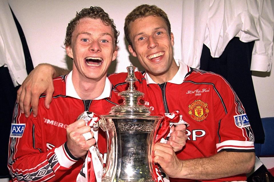 <p>Ole Gunnar Solskjaer and Ronny Johnson celebrate FA Cup glory in 1999</p> (Manchester United via Getty Imag)