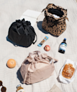"""We wouldn't blame you if you want to use this very fashionable lunch tote as an everyday bag. Not only does this drawstring design look impossibly chic, but it also has an insulated lining, water resistant interior, and it's roomy enough to fit a water bottle or thermos. $42, Calpak. <a href=""""https://www.calpaktravel.com/products/insulated-lunch-bag/black?variant=32256420053050&currency=USD&utm_medium=product_sync&utm_source=google&utm_content=sag_organic&utm_campaign=sag_organic&utm_term=&utm_campaign=AV_GoalOptimized+Shopping_Compakt&utm_source=adwords&utm_medium=ppc&hsa_acc=1275500925&hsa_cam=14173663656&hsa_grp=127045398193&hsa_ad=537710665133&hsa_src=u&hsa_tgt=pla-1393905760933&hsa_kw=&hsa_mt=&hsa_net=adwords&hsa_ver=3&gclid=Cj0KCQjwu7OIBhCsARIsALxCUaMje6O_8NbuMJiNk01BvSic7UenAmzK5KMZAL9SCKappsMi4SX3WeMaAilYEALw_wcB"""" rel=""""nofollow noopener"""" target=""""_blank"""" data-ylk=""""slk:Get it now!"""" class=""""link rapid-noclick-resp"""">Get it now!</a>"""
