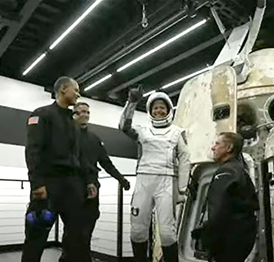 In this image taken from video, Sian Proctor, one of four passengers aboard the SpaceX capsule, reacts after emerging from the capsule Saturday, Sept. 18, 2021, after it was recovered following its splashdown in the Atlantic off the Florida coast. The all-amateur crew was the first to circle the world without a professional astronaut. (Inspiration4 via AP)