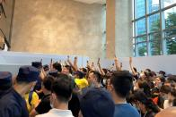 People protest to demand repayment of loans and financial products at the Evergrande's headquarters, in Shenzhen