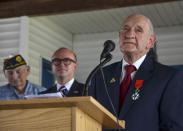 WWII veteran Jimmie H. Royer thanks everyone at the ceremony where Royer was awarded France's Legion of Honor at VFW Post 346 in Terre Haute, Ind., Sunday, Sept. 29, 2019. The 94-year-old World War II veteran from western Indiana received the medal Sunday for his wartime service. (Austen Leake/The Tribune-Star via AP)