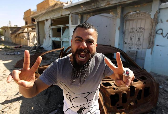 A man celebrates in the streets of Benghazi on February 23, 2016 (AFP Photo/Abdullah Doma)