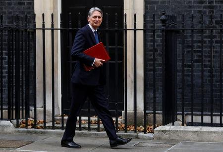 Britain's Chancellor of the Exchequer Philip Hammond arrives at 10 Downing Street in London