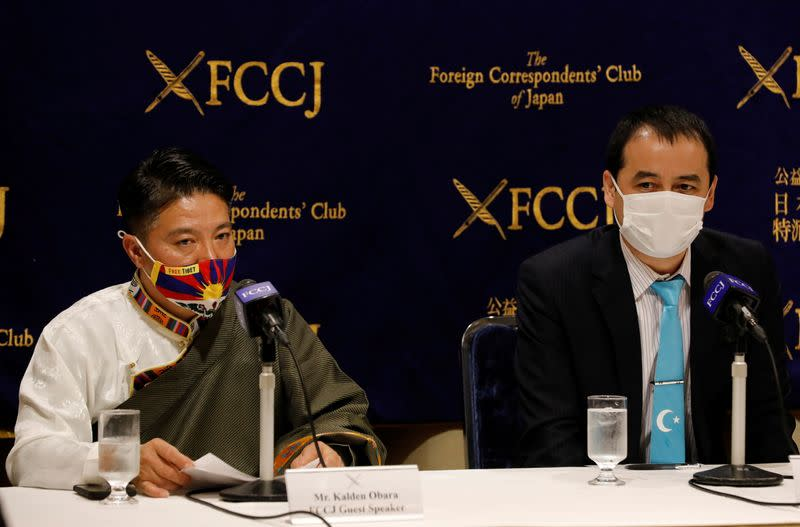 Activists attend a news conference against China hosting the 2022 Winter Olympic Games in Tokyo