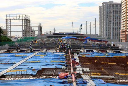 Workers lay out steel bars in constructing the 8-kilometer 4-lane elevated highway along Buendia avenue in Makati City, metro Manila