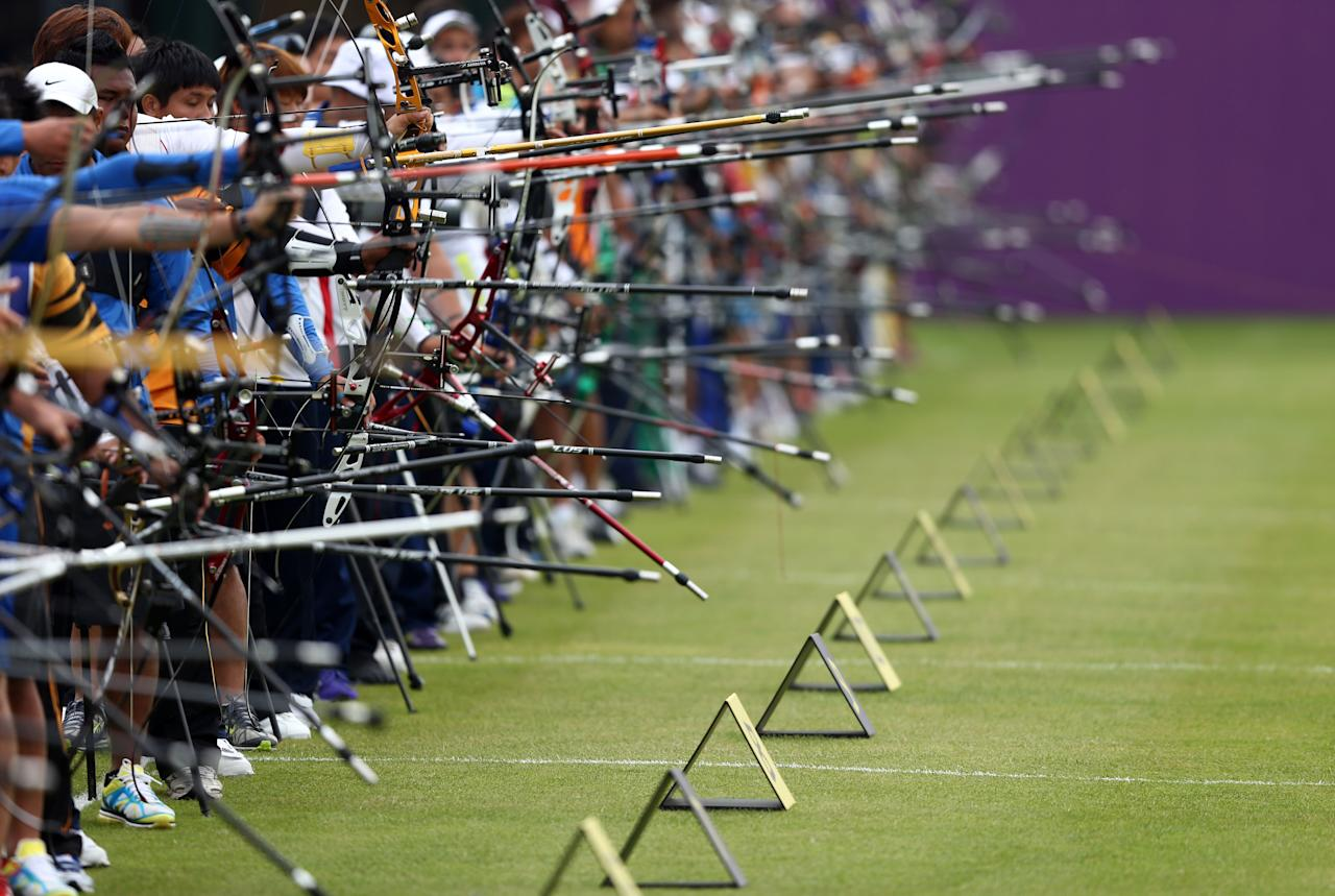 LONDON, ENGLAND - JULY 27:  Competitors take aim during the Archery Ranking Round on Olympics Opening Day as part of the London 2012 Olympic Games at the Lord's Cricket Ground on July 27, 2012 in London, England.  (Photo by Paul Gilham/Getty Images)