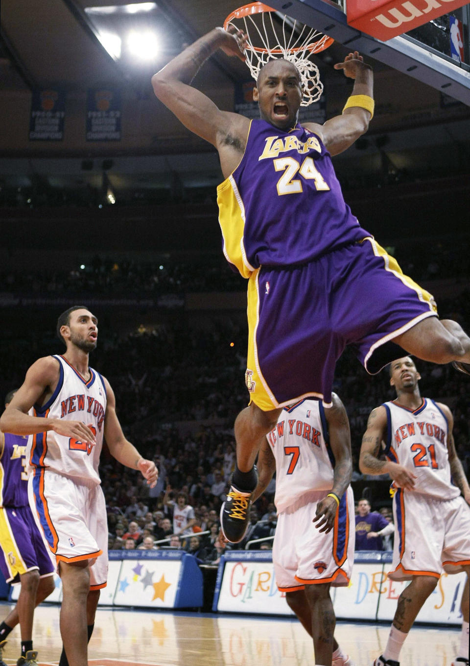 FILE - In this Feb. 2, 2009 file photo Los Angeles Lakers guard Kobe Bryant (24) reacts after a slam dunk shot in the first half of an NBA basketball game at Madison Square Garden in New York. Bryant had 61 points in the game. Bryant, the 18-time NBA All-Star who won five championships and became one of the greatest basketball players of his generation during a 20-year career with the Los Angeles Lakers, died in a helicopter crash Sunday, Jan. 26, 2020. (AP Photo/Kathy Willens)