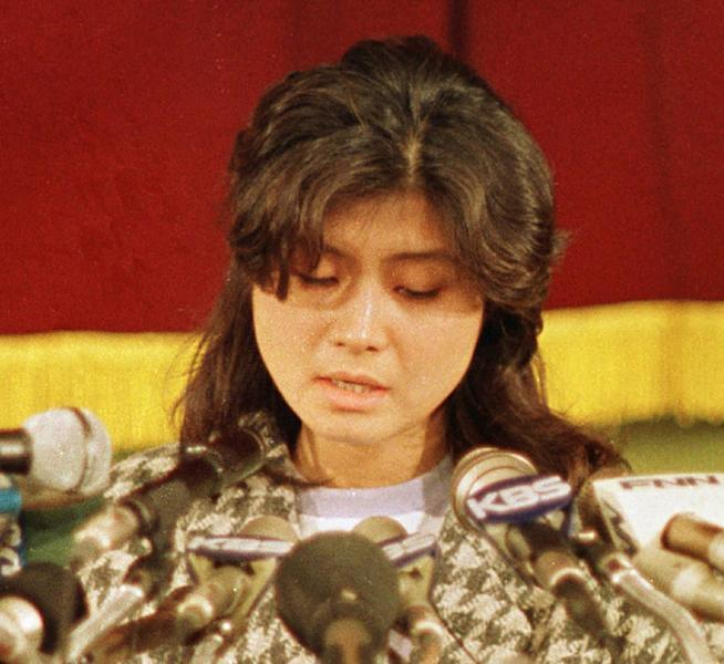 FILE - In this Jan. 15, 1988, file photo, Kim Hyon-hui, a North Korean who bombed a Korean Air Lines jet in 1987, confesses at a press conference in Seoul, South Korea. In November 1987, Kim and the other North Korean agent posing as a father and daughter left a time bomb on the South Korean jetliner when it stopped in Abu Dhabi during a flight from Baghdad to Seoul. The plane exploded off the coast of Myanmar, killing all 115 people aboard, South Korean investigators say. (AP Photo/Bei Yeon-Hong, File)